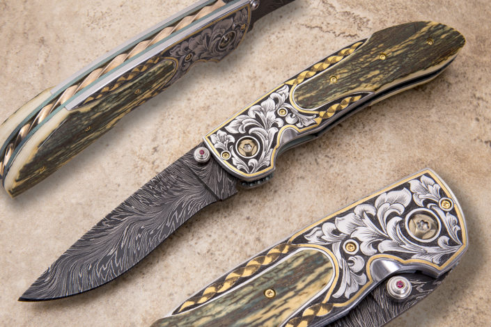 "This is my newest model, The ""Falcon"". This one is based on the design of my popular Protege Fine Folder. It's fitted with a 3 3/8"" blade of Bill Burke, River of Fire, Damascus steel, 24ct gold inlay engraving by Alice Carter, handle scales fitted with museum grade green fossilized mammoth ivory, and file worked Mokume backspacer. Available for immediate delivery. Free shipping in USA, $5395.00."
