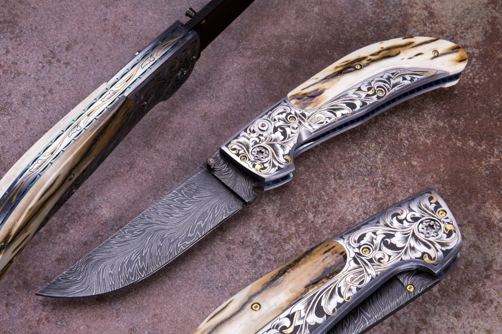 """SOLD - The Vaquero, Double Action Automatic, fitted with a 3 3/4"""" River of Fire Damascus blade forged by Bill Burke, 416 SS bolsters engraved by Alice Carter, and Presentation grade mammoth ivory scales. The """"Compadre"""". This prototype Linerlock folder is fitted with a 3"""" Doug Ponzio, Turkish Twist Damascus blade, nitre blued Robert Eggerling Mosiac Damascus Bolsters, beautifully engraved by Alice Carter, with inlaid copper and 24k gold. The Mother of Pearl scales are also engraved by Alice Carter. Price $5950.00. Click on image for a hi resolution view."""