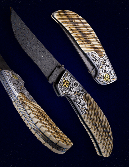 "The ""Vaquero"" Double Action Auto, fitted with a 3 3/4"" blade of Doug Ponzio's Turkish Twist Damascus, fluted Mammoth ivory scales with 14k gold wire inlays, and hand engraved bolsters and backspacer by Master Engraver, Wes Griffin. Available for immediate delivery $6950.00. Click on image for hi res picture."
