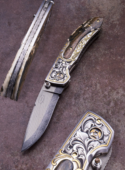 """The """"Patrón"""". SOLD - My newest model Double Action Automatic. It's fitted with Owen Wood's, 3 3/8"""", Premium Damascus blade, with engraved bolsters by Julie Warenski. The hande scales are Presentation grade fossilized mammoth ivory. Click on image to view in High resolution."""