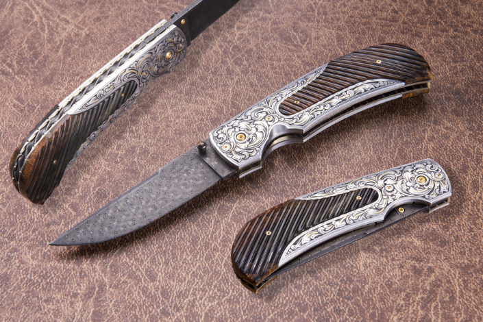"""The """"Zenith"""". Fitted with a 3"""" Turkish Twist Damascus blade forged by Doug Ponzio, engraved 416 SS bolsters engravved by Brian Bump, and fluted mammoth ivory scales. Available for immediate delivery $4895.00. Click on image for hi res picture."""