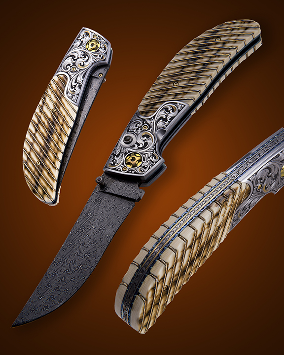 """The """"Vaquero"""" Double Action Auto, fitted with a 3 3/4"""" blade of Doug Ponzio's Turkish Twist Damascus, fluted Mammoth ivory scales with 14k gold wire inlays, and hand engraved bolsters and backspacer by Master Engraver, Wes Griffin. Available for immediate delivery $6950.00. Click on image for hi res picture."""